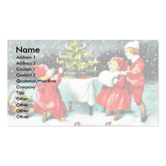 Christmas greeting with children playing around th pack of standard business cards