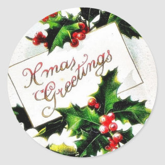 Christmas greeting with holy leaves classic round sticker