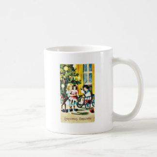 Christmas greeting with kids playing infront of a mug
