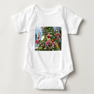 Christmas manniquins on a tree baby bodysuit