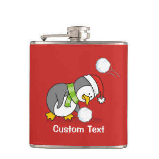 Christmas penguin getting a snow ball hip flask