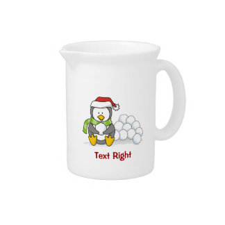 Christmas penguin sitting with snow balls pitcher
