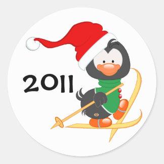 Christmas Penguin Skiing Classic Round Sticker