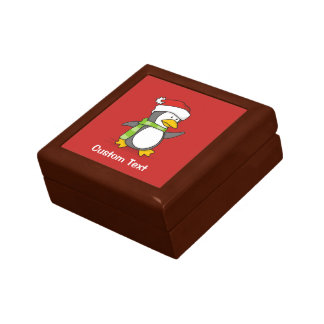 Christmas penguin walking on snow gift box