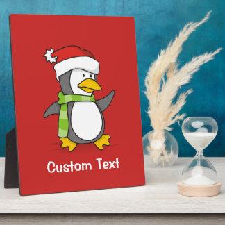 Christmas penguin walking on snow plaque