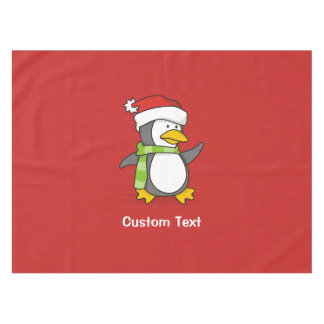 Christmas penguin walking on snow tablecloth