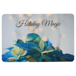 Christmas poinsettias in blue floor mat