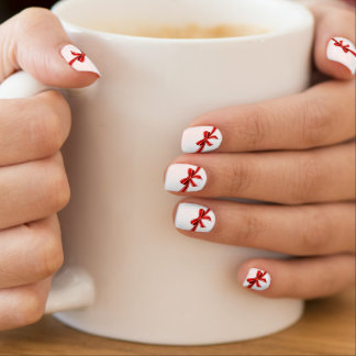 christmas present red ribbon bow on white minx nail art