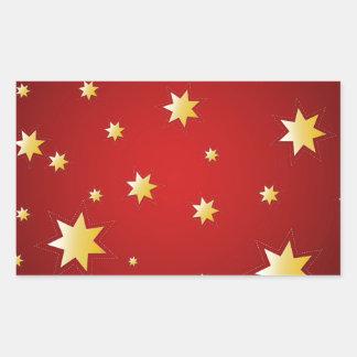 Christmas sparkling golden stars on red rectangular sticker
