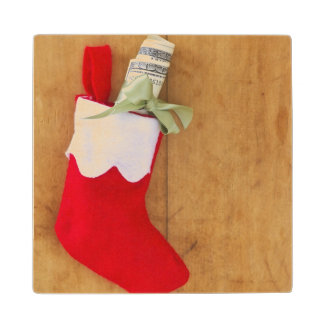 Christmas stocking with roll of money wood coaster