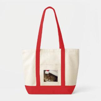 Christmas tote bag has cat wearing a santa hat