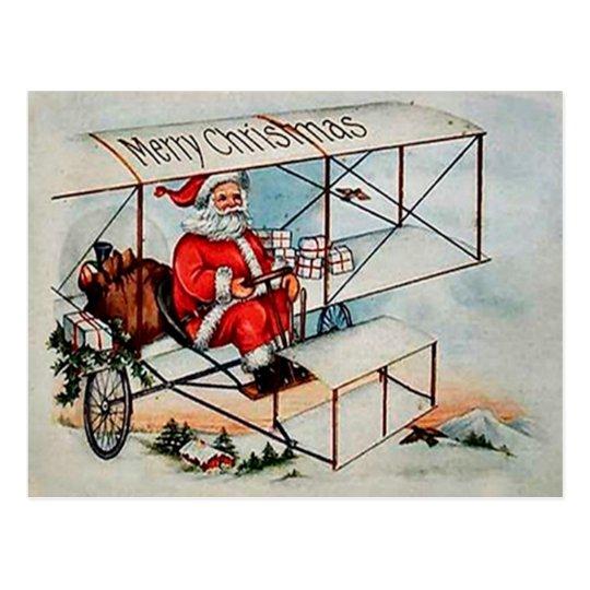 Christmas Vintage Santa on aeroplane Postcard