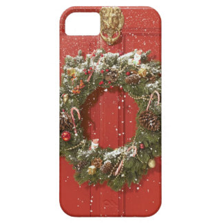 Christmas wreath hanging on a door case for the iPhone 5