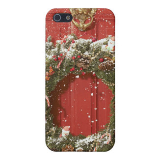 Christmas wreath hanging on a door iPhone 5 cover