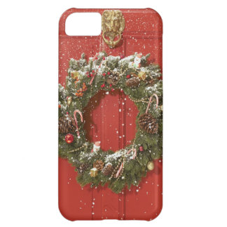 Christmas wreath hanging on a door iPhone 5C case