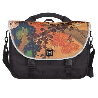 Chrysanthemums by a stream laptop bag