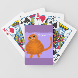 Chubby red tabby cat playing cards