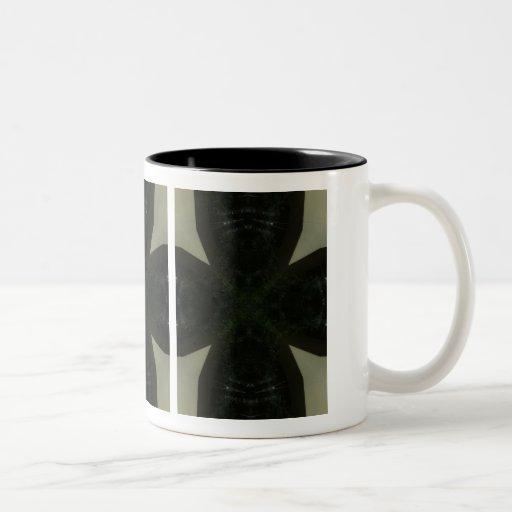 Chunky black cross on light green mugs
