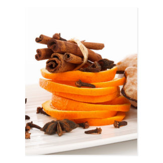 Cinnamon, star anise, cloves and orange slices post card