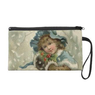 Circa 1871: A young girl in the snow Wristlet