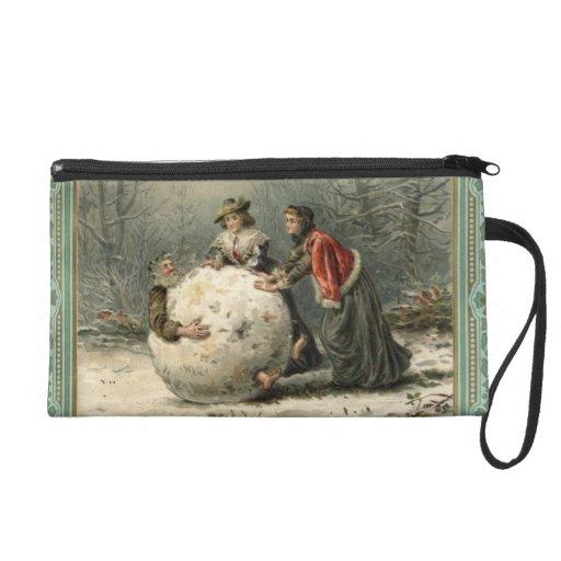 Circa 1879: Two women roll man in snow Wristlet Purses