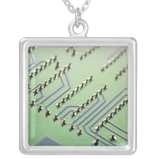 Circuit board photographed close up. The Silver Plated Necklace