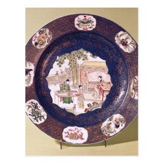 Circular dish with a musical scene postcard
