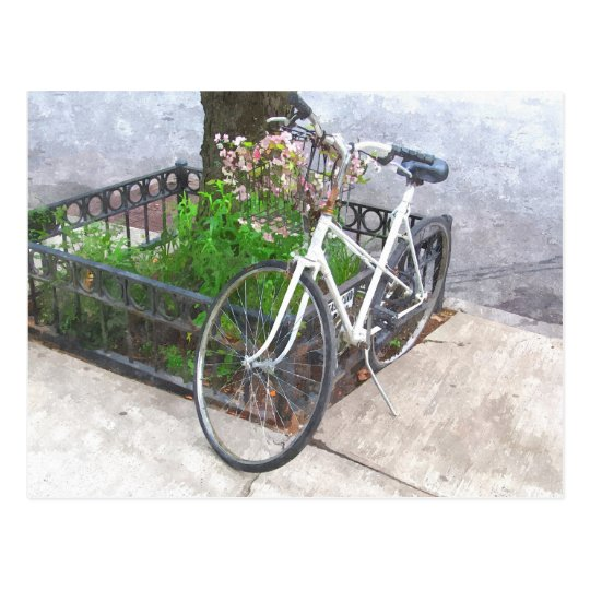 CITY BIKE WITH BASKET COVERED IN FLOWERS POOSTCARD
