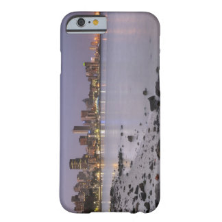 City lights at twilight with debris strewn beach barely there iPhone 6 case