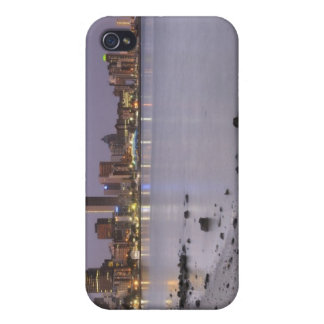City lights at twilight with debris strewn beach cases for iPhone 4
