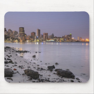 City lights at twilight with debris strewn beach mouse pad
