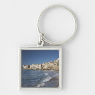 City of old buildings on beach key ring