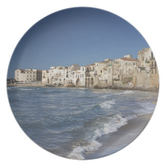 City of old buildings on beach plates