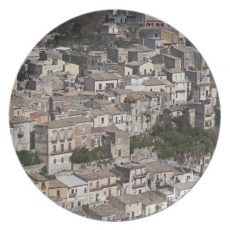 City of old buildings on hillside plate