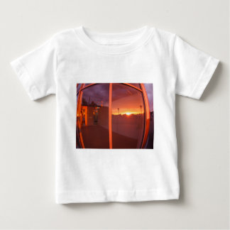 Cityscape at sunset, which is reflected in the win tshirts