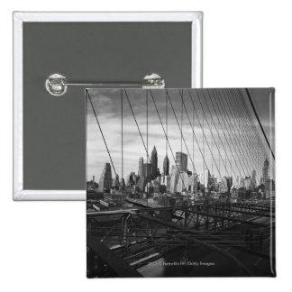 Cityscape through bridge cables 15 cm square badge