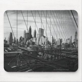 Cityscape through bridge cables mouse mat