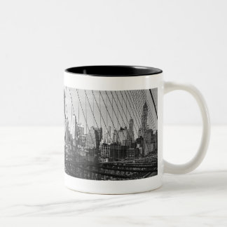 Cityscape through bridge cables Two-Tone coffee mug
