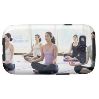 Class of women performing the meditative samsung galaxy SIII covers