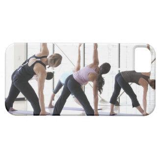 Class of women performing Utthita Trikonasana iPhone 5 Case