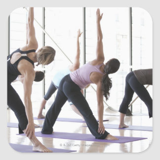 Class of women performing Utthita Trikonasana Square Sticker