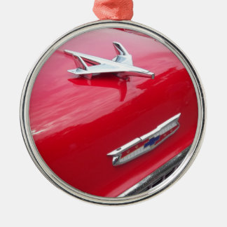 Classic aero style hood ornament with red paint