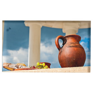 Classic antique still-life with a pitcher table card holder