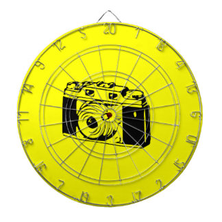 Classic Vintage Film Camera Upon Yellow Backround Dartboard With Darts
