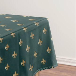 Classy golden like fleur de lis on dark sea green tablecloth
