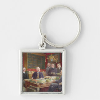 Claude Auge  in his Office with his Colleagues Silver-Colored Square Key Ring