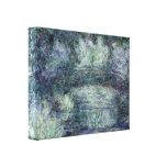 Claude Monet - Bridge in garden Stretched Canvas Print