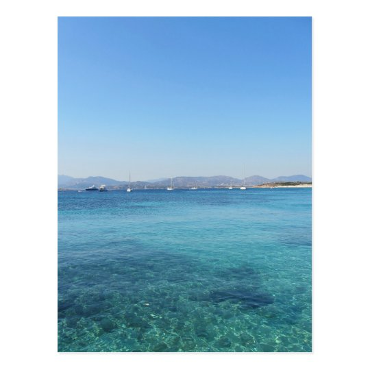 Clear turquoise sea water and boats on the