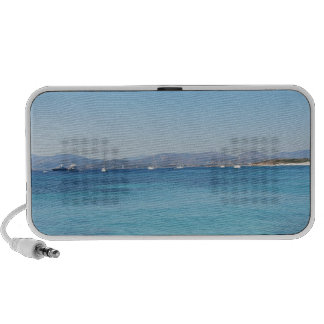 Clear turquoise sea water and boats on the horizon laptop speaker