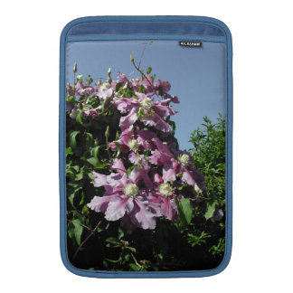 Clematis. Pink Flowers, and blue sky. MacBook Sleeve